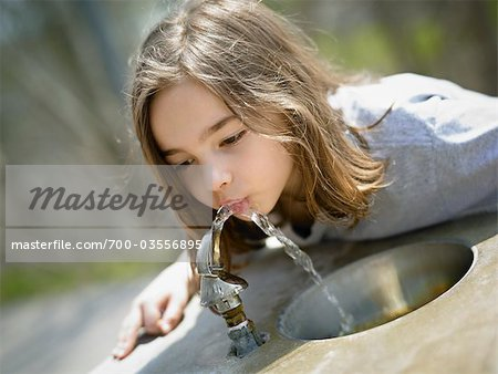 Girl Drinking Water from Drinking Fountain Stock Photo - Rights-Managed, Image code: 700-03556895