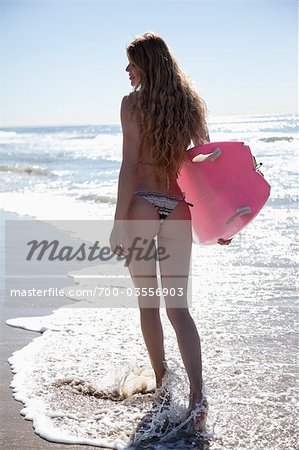 Backview of Young Woman Walking on Beach holding Surfboard, Zuma Beach, California, USA Stock Photo - Rights-Managed, Image code: 700-03556903
