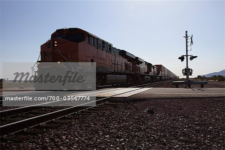 Freight Train at Railway Crossing, Eastern California, USA Stock Photo - Rights-Managed, Image code: 700-03567774