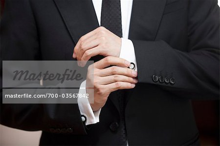 Close-up of Groom Adjusting Cuff Links Stock Photo - Rights-Managed, Image code: 700-03567842