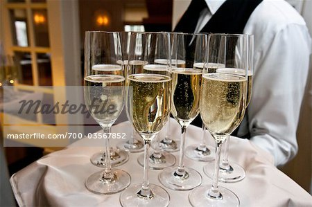 Waiter Holding Tray of Champagne Stock Photo - Rights-Managed, Image code: 700-03567852
