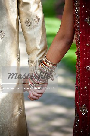 Close-up of Bride and Groom Holding Hands Stock Photo - Rights-Managed, Image code: 700-03567855