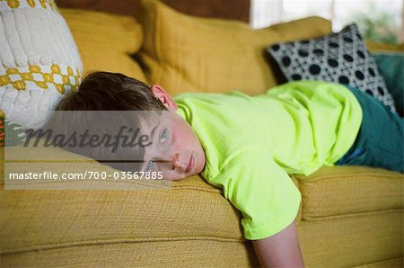 Teenage Boy Lying on the Couch Stock Photo - Rights-Managed, Image code: 700-03567885