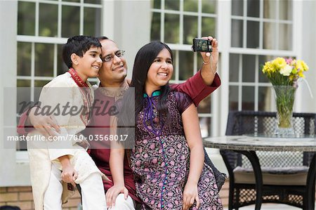 Father and Kids Taking Pictures of Themselves Stock Photo - Rights-Managed, Image code: 700-03568017