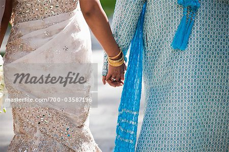 Bride and Groom Holding Hands Stock Photo - Rights-Managed, Image code: 700-03587196