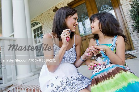 Mother Painting Daughter's Finger Nails Stock Photo - Rights-Managed, Image code: 700-03596271