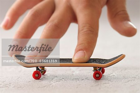 Boy's Hand with Toy Skateboard Stock Photo - Rights-Managed, Image code: 700-03601359