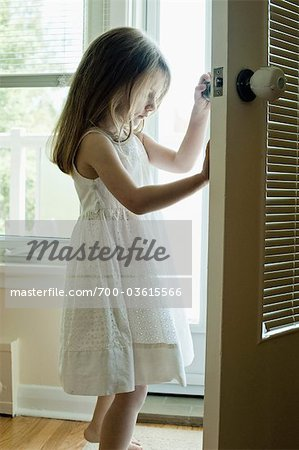 Girl in Doorway Stock Photo - Rights-Managed, Image code: 700-03615566