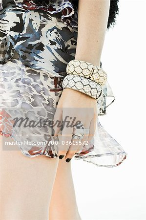 Close-up of Woman Wearing Rings, Bracelets and Dress Stock Photo - Rights-Managed, Image code: 700-03615572