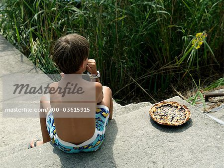 Little Boy With Cake, Province of La Spezia, Liguria, Italy Stock Photo - Rights-Managed, Image code: 700-03615915