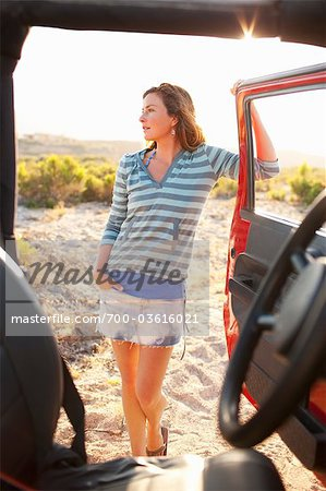 Woman Standing by 4x4 Vehicle in the Desert at Sunset, Near Cabo Pulmo, Baja California Sur, Mexico Stock Photo - Rights-Managed, Image code: 700-03616021
