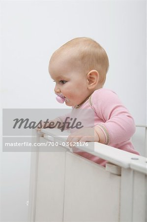 Baby Girl in Crib Stock Photo - Rights-Managed, Image code: 700-03621176