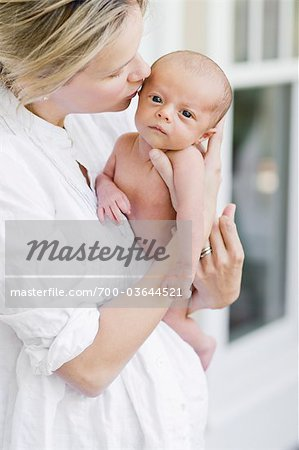 Woman Kissing Baby Stock Photo - Rights-Managed, Image code: 700-03644521