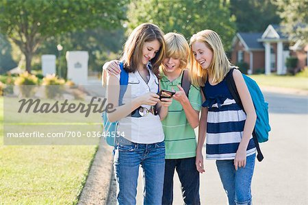 Group of Friends with Cell Phone Going to School Stock Photo - Rights-Managed, Image code: 700-03644534