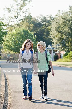 Boy and Girl Walking and Holding Hands Stock Photo - Rights-Managed, Image code: 700-03644535