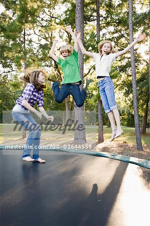 Group of Friends Jumping on Trampoline Stock Photo - Rights-Managed, Image code: 700-03644539
