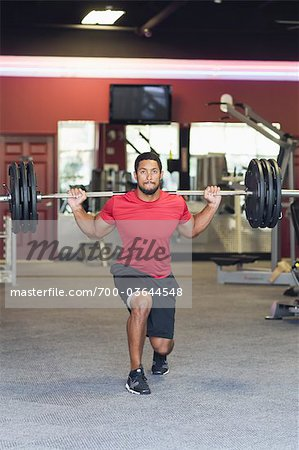 Man Lifting Weights in Gym Stock Photo - Rights-Managed, Image code: 700-03644548