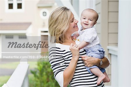 Mother and Son Outside of Home Stock Photo - Rights-Managed, Image code: 700-03644558