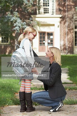 Mother Walking Daughter to School Stock Photo - Rights-Managed, Image code: 700-03644811