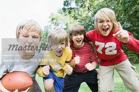 Boys Playing Football Stock Photo - Rights-Managed, Image code: 700-03659103