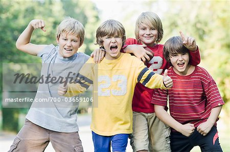Boys, Outside, Park, summer, friends, sports, football, team Stock Photo - Rights-Managed, Image code: 700-03659106
