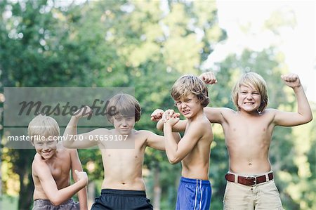 Boys Flexing Muscles Stock Photo - Rights-Managed, Image code: 700-03659107