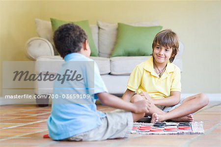 Boys Playing Checkers Stock Photo - Rights-Managed, Image code: 700-03659109