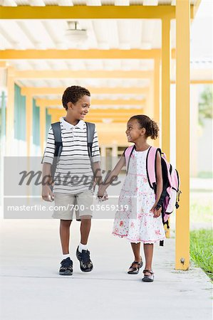 Brother and Sister Walking Together at School Stock Photo - Rights-Managed, Image code: 700-03659119