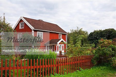 Red wooden house, Bullerbue, Smaland, Sweden Stock Photo - Rights-Managed, Image code: 700-03659289