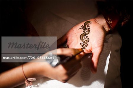 Bride Having Henna Applied to Hand Stock Photo - Rights-Managed, Image code: 700-03665601