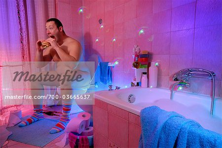 Nude Man Sitting on Toilet Eating a Sandwich Stock Photo - Rights-Managed, Image code: 700-03665637