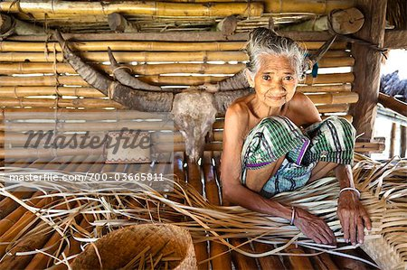 Woman Weaving Palm Frond Mat, Sumba, Indonesia