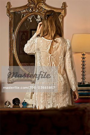 Back of Woman Wearing Lingerie and Looking into Mirror Stock Photo - Rights-Managed, Image code: 700-03665857