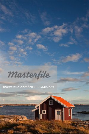 Red Wooden Hut on Shoreline, Bohuslaen, Vastra Gotaland County, Gotaland, Sweden Stock Photo - Rights-Managed, Image code: 700-03685779