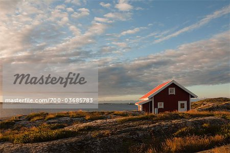Red wooden hut on coast, Bohuslaen, Sweden Stock Photo - Rights-Managed, Image code: 700-03685783