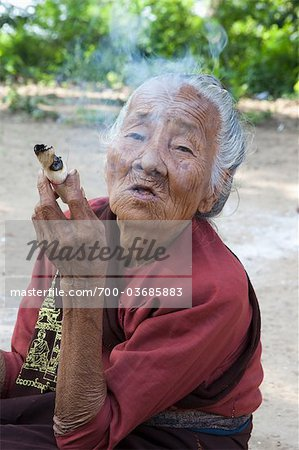 Portrait of Senior Woman Smoking, Monywa, Myanmar Stock Photo - Rights-Managed, Image code: 700-03685883
