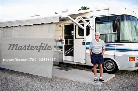 Man Standing in front RV in Trailer Park, Yuma, Arizona, USA Stock Photo - Rights-Managed, Image code: 700-03686137