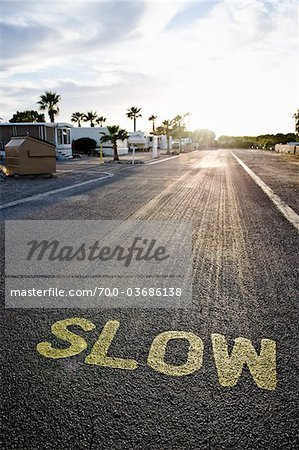'Slow' Traffic Sign on Street in RV Park, Yuma, Arizona, USA Stock Photo - Rights-Managed, Image code: 700-03686138