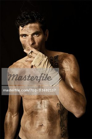 Dirty Guy Smoking and Wearing Boxing Wraps Stock Photo - Rights-Managed, Image code: 700-03692137
