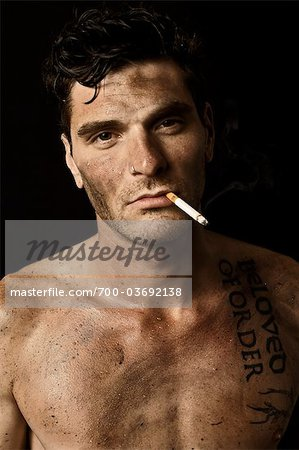 Dirty Guy Smoking Stock Photo - Rights-Managed, Image code: 700-03692138