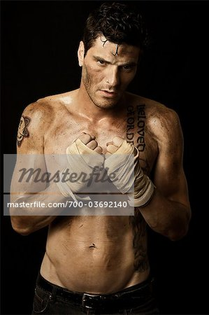 Dirty Man with Fists Wrapped in Boxing Hand Wraps Stock Photo - Rights-Managed, Image code: 700-03692140