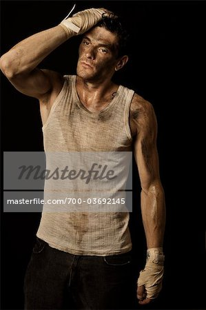 Dirty Sweaty Guy Wearing Boxing Wraps and Tank Top Stock Photo - Rights-Managed, Image code: 700-03692145