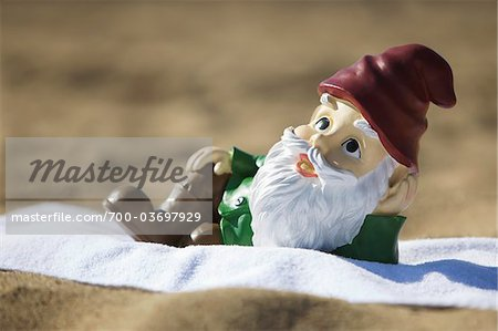 Gnome Relaxing on the Beach Stock Photo - Rights-Managed, Image code: 700-03697929