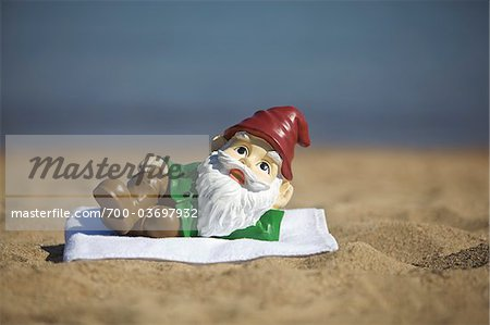 Gnome Relaxing on the Beach Stock Photo - Rights-Managed, Image code: 700-03697932