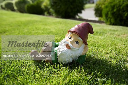 Gnome Relaxing on Lawn Stock Photo - Rights-Managed, Image code: 700-03697935