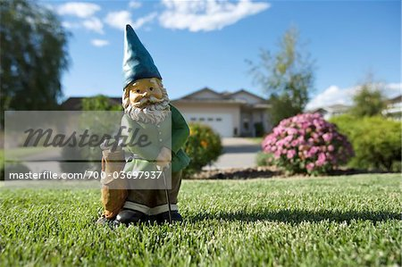 Golfing Gnome Statue on Lawn, Pentiction, Okanagan Valley, British Columbia, Canada Stock Photo - Rights-Managed, Image code: 700-03697937