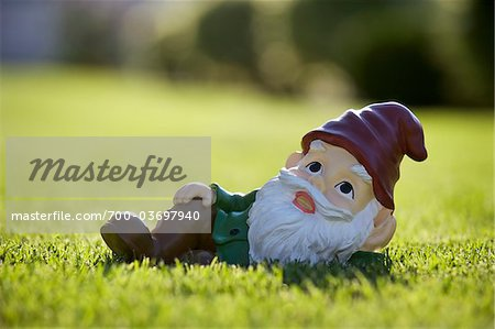 Gnome Relaxing on Lawn Stock Photo - Rights-Managed, Image code: 700-03697940