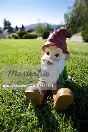 Gnome Sitting on Lawn Stock Photo - Rights-Managed, Image code: 700-03697941