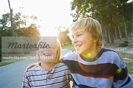 Brothers Outdoors with Arms Around Each Other Stock Photo - Rights-Managed, Image code: 700-03719320