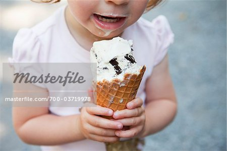 Little Girl Eating Ice Cream Stock Photo - Rights-Managed, Image code: 700-03719978